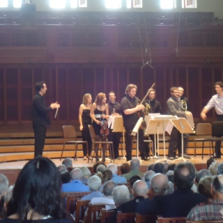 Adam Roberts congratulating the ensemble after a performance of his Impulse Fracture